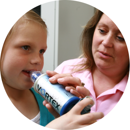 Young girl performing a test to diagnose her asthma