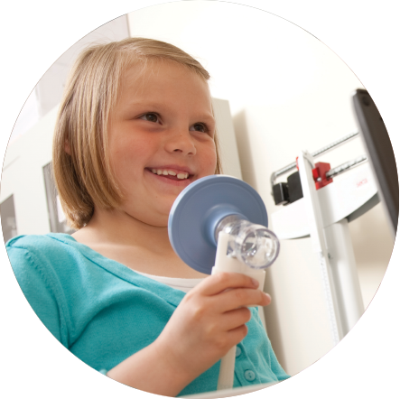 Young girl at the doctor to treat her asthma