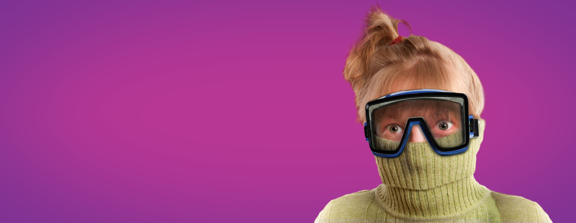 Young girl in a turtleneck pulled up over her nose with swim goggles on her face